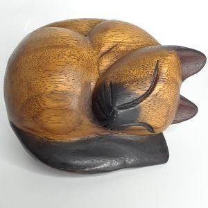 Carved wood sleeping kitty cat figure